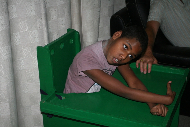 young girl hip problems foot deformed double orphan Lusaka Zambia UK aid